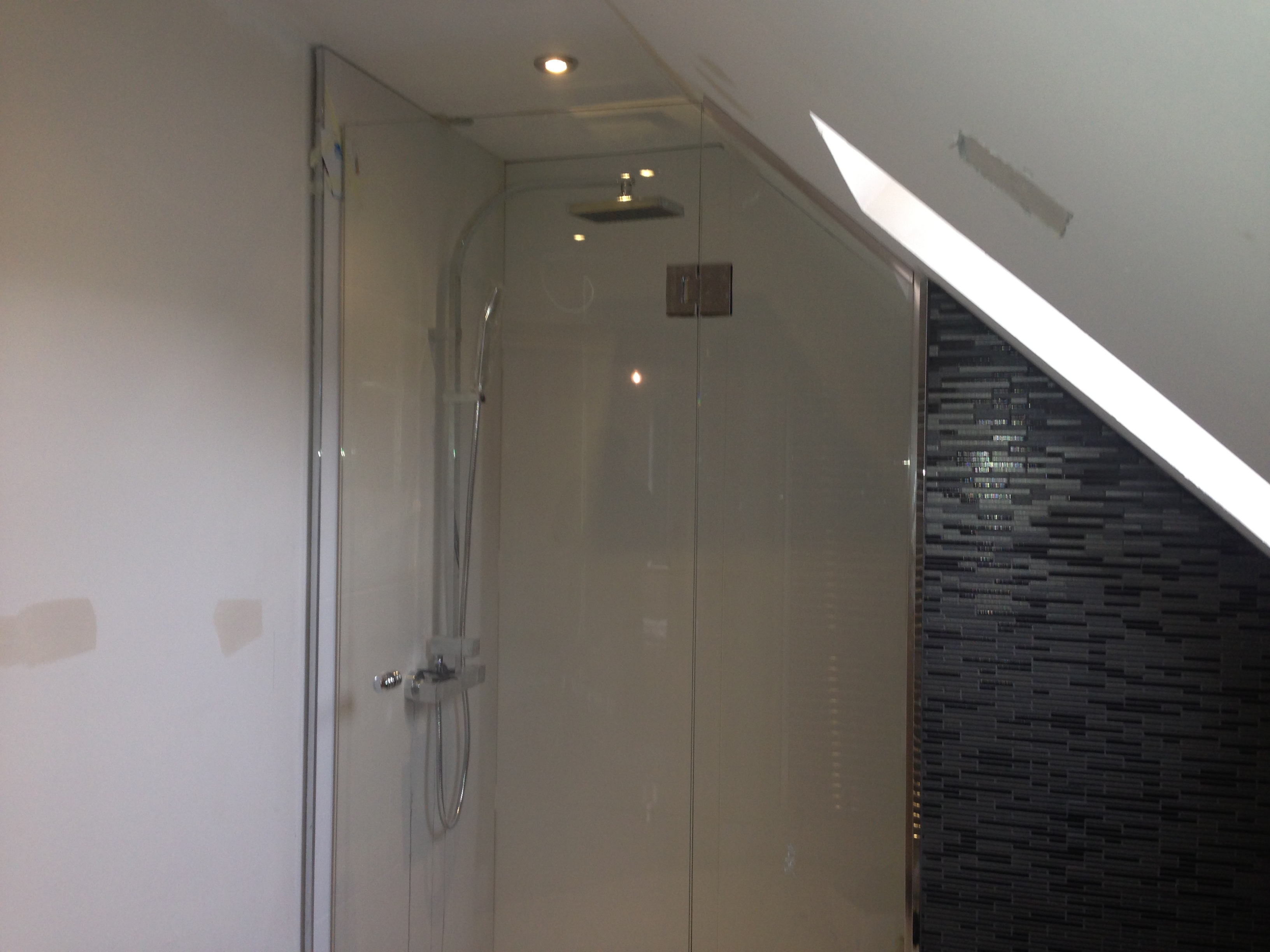 Glass shower screens bespoke solid surfaces limited for Solid glass shower doors