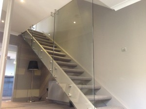 bespoke balustrade with stand offs  and top wall mounts