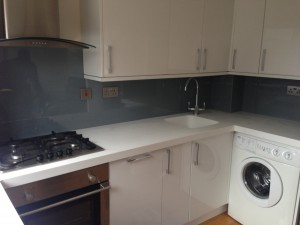 light grey splash backs with white corian worktops