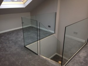 glass balustrade fitted with u channel and uv bonded corners