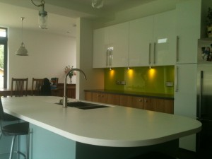 granite work tops with green splash backs
