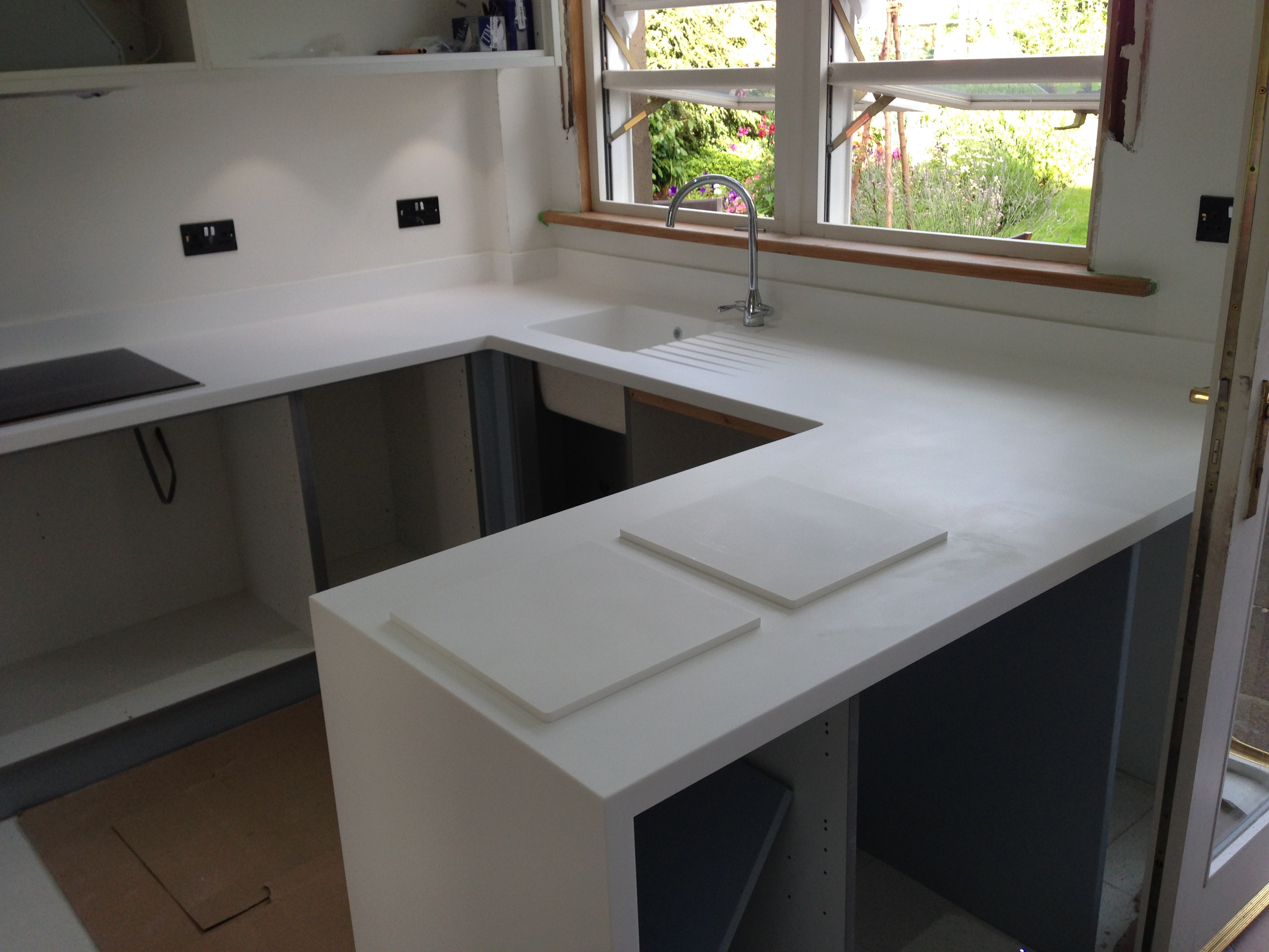 builders solidsurface wilharm remodel corian page kitchen countertops archives blog with surface solid gloede white com
