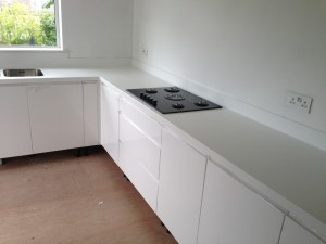 white corian with stainless steel sink