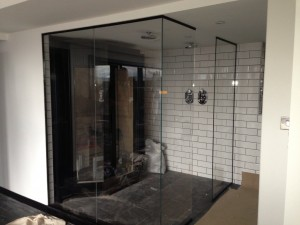 Bespoke shower screen fitted with black Chanel